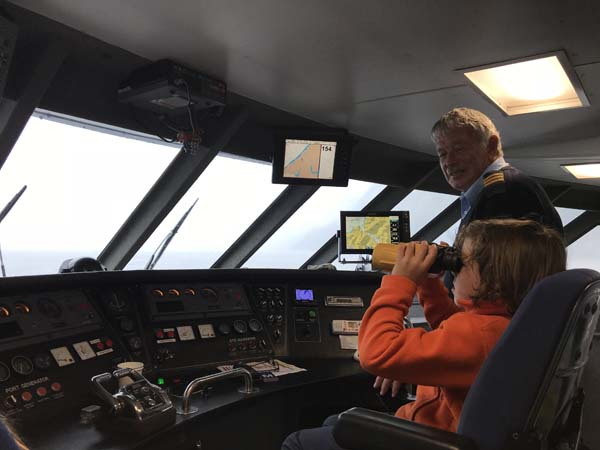 Parker Captaining the boat!